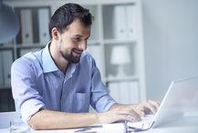 186066717-bearded-man-laptop-large