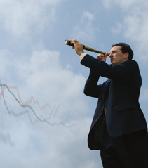 Business man using telescope
